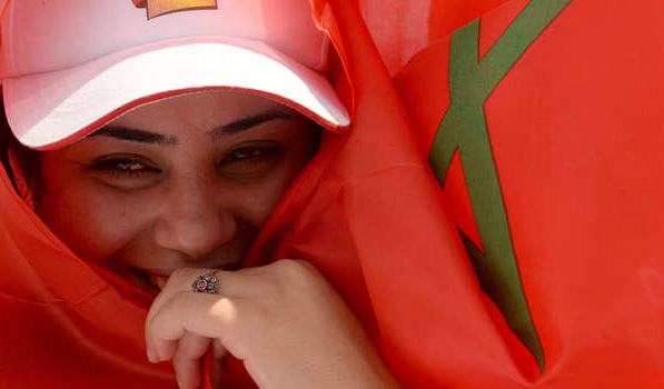 A Moroccan woman wrapped in her national flag takes part in a rally organized by the Moroccan Unions and marking the International Labour Day on May 1, 2014 in Casablanca. AFP PHOTO / FADEL SENNA        (Photo credit should read FADEL SENNA/AFP/Getty Images)